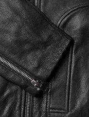 Ganni - Light Grain Leather - nahkatakit - black - 4
