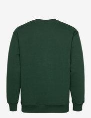 GANT - D1. GANT ROYAL CREST C-NECK - tops - tartan green - 1