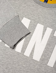 D1. GRAPHIC C-NECK SWEAT