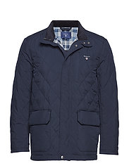 O1. THE QUILTED CITY JACKET - NAVY