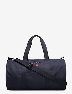 D1. MEDIUM SHIELD GYM BAG - EVENING BLUE
