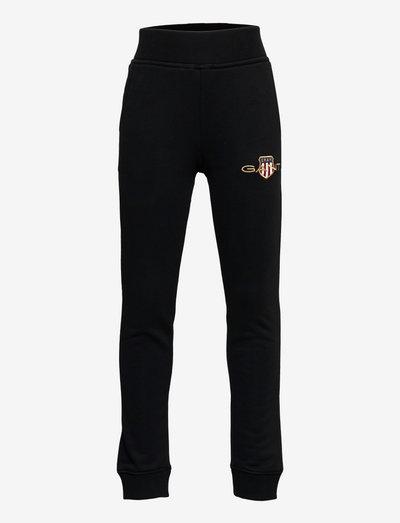 D1. ARCHIVE SHIELD  SWEAT PANTS - jogginghosen - black
