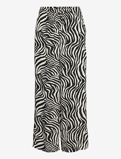 Disa trousers - leveälahkeiset housut - zebra