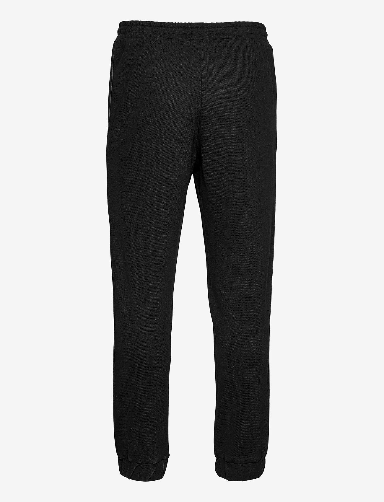 HAN Kjøbenhavn - Track Pants - kleding - black pique - 1