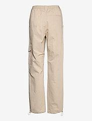 HAN Kjøbenhavn - Cargo Track Pants - raka byxor - off white - 1