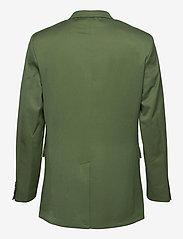 HAN Kjøbenhavn - Boxy Blazer - kostuums met dubbele knopen - dark green - 1