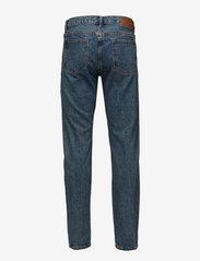 HAN Kjøbenhavn - Tapered Jeans - regular jeans - heavy stone wash - 1