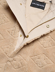 HAN Kjøbenhavn - Track Fleece - mid layer jackets - sand logo - 2