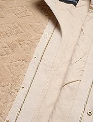 HAN Kjøbenhavn - Track Fleece - mid layer jackets - sand logo - 4