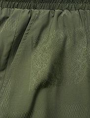 HAN Kjøbenhavn - Track Skirt - korta kjolar - green tribal - 2