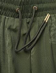 HAN Kjøbenhavn - Track Skirt - korta kjolar - green tribal - 3