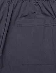 HAN Kjøbenhavn - Tapered Trousers - chino's - dusty navy - 4