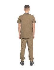 HAN Kjøbenhavn - Casual Tee - basic t-shirts - green crush - 4