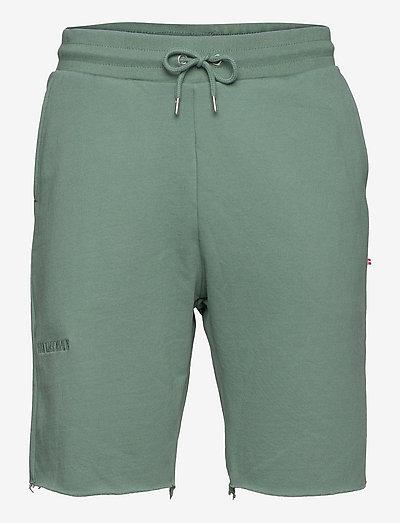 Sweat shorts - short décontracté - dusty green logo