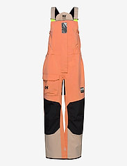 Helly Hansen - W PIER BIB - pantalon de randonnée - melon - 0