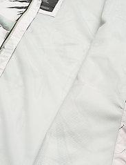 Helly Hansen - W BELFAST II PACKABLE JACKET - manteaux de pluie - cream esra print - 8