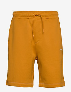 Falk Shorts - casual shorts - ocher yellow