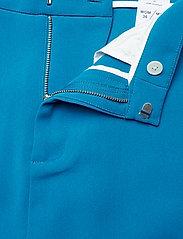 Hope - Move Trousers - slim fit broeken - blue - 4