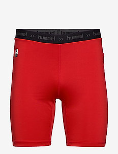 HML FIRST PERFORMANCE TIGHT SHORTS - training shorts - true red