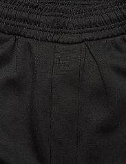 Hummel - hmlTROPPER TAPERED PANTS - pants - black - 3