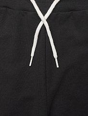 Hummel - hmlNUEVE PANTS - sweatpants - black - 3