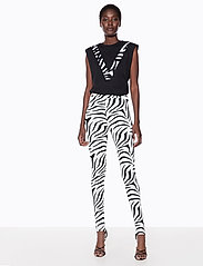 Ivyrevel - HIGH WAIST STIRRUP PANTS - leggings - zebra print - 0