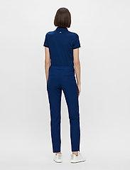 J. Lindeberg Golf - Dana Golf Pant - sports pants - midnight blue - 6