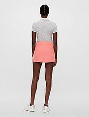 J. Lindeberg Golf - Amelie Golf Skirt - sports skirts - tropical coral - 5