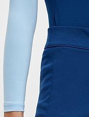J. Lindeberg Golf - Amelie Mid Golf Skirt - sports skirts - midnight blue - 5
