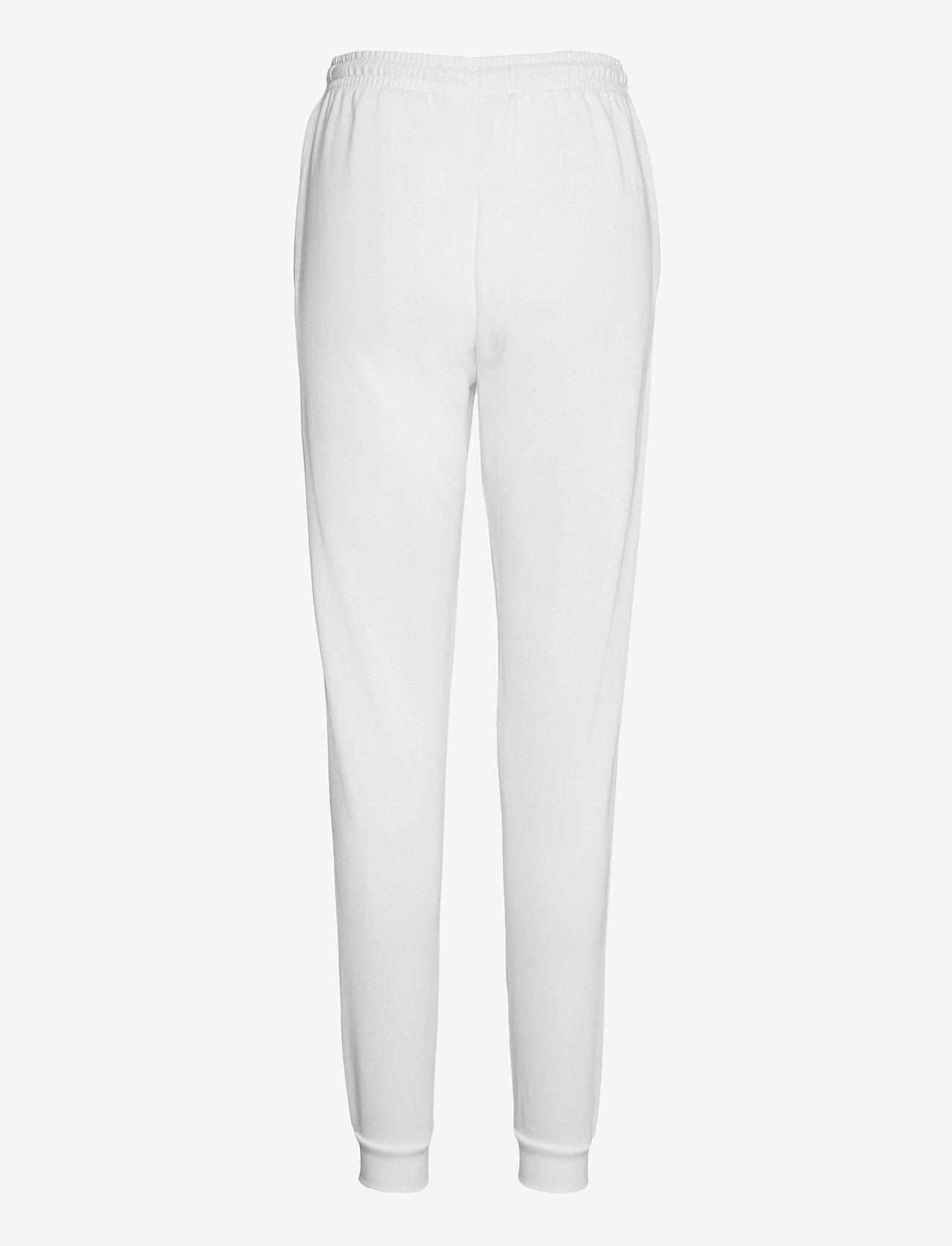 Lacoste - Women tracksuit trousers - sportbroeken - white - 1