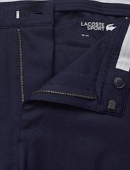 Lacoste - Men s leisure trousers - golf-housut - navy blue - 3
