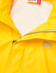 Lego wear - LWJOSHUA 212 - RAIN JACKET - vestes - dark yellow - 5