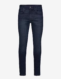 SKINNY TAPER SAGE OVERT ADV TN - skinny jeans - dark indigo - worn in
