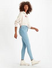 LEVI´S Women - MILE HIGH SUPER SKINNY BETWEEN - skinny jeans - light indigo - flat finis - 0