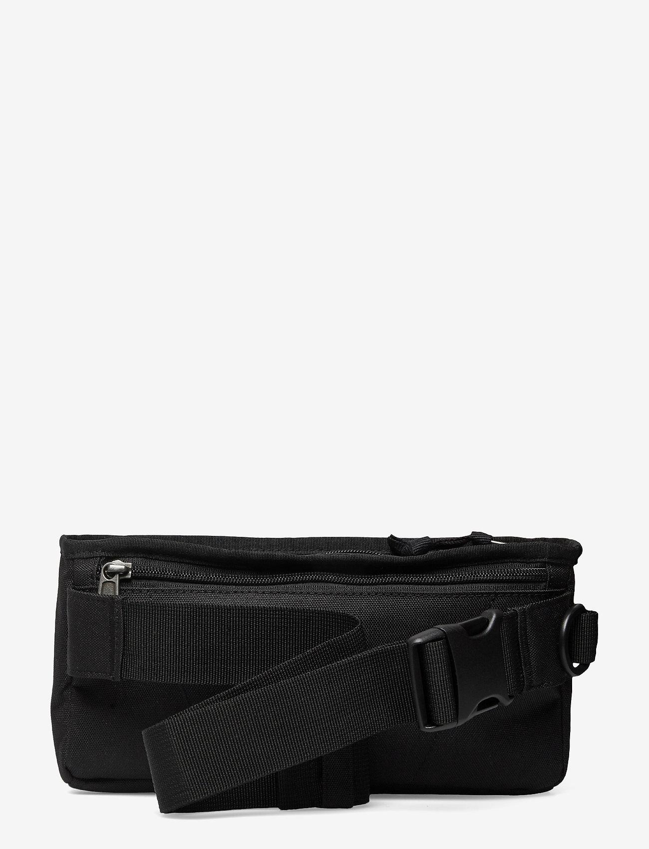 Levi's Footwear & Acc - Multi Pocket Banana Sling OV - trousses de toilette - regular black - 1