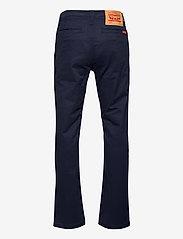 Levi's - LVB 511 SLIM FIT XX CHINOS - trousers - navy blazer - 1