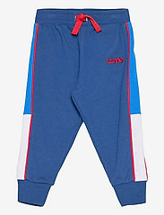 Levi's - COLORBLOCK JOGGER - trousers - estate blue - 0