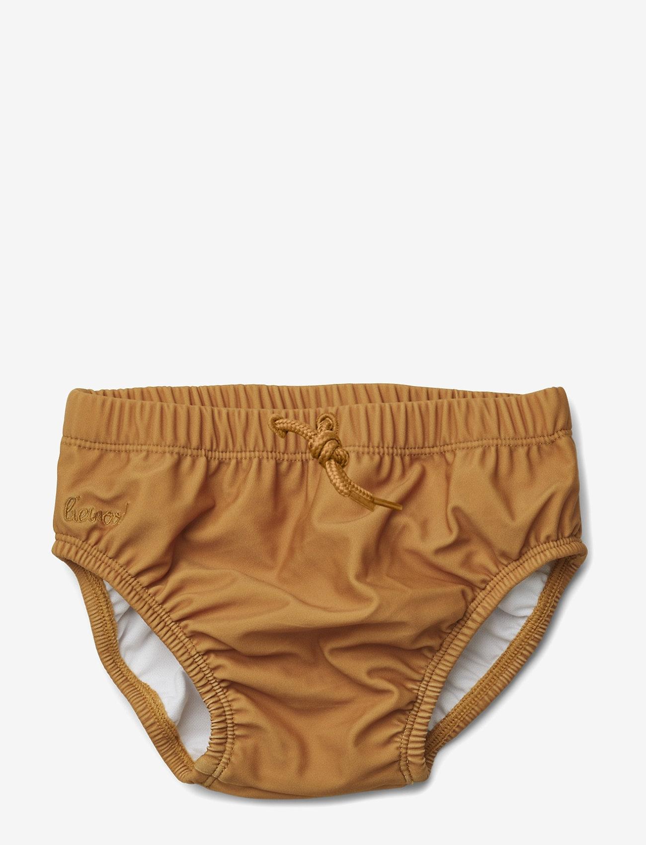 Liewood - Lucas baby boy swim pants - stroje kąpielowe - mustard - 0