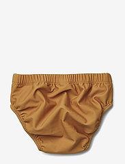 Liewood - Lucas baby boy swim pants - stroje kąpielowe - mustard - 1