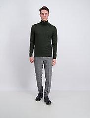 Merino knit roll-neck