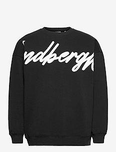 Placement print logo sweatshir - tops - black