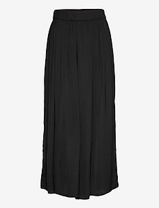 Trousers Malin - leveälahkeiset housut - black