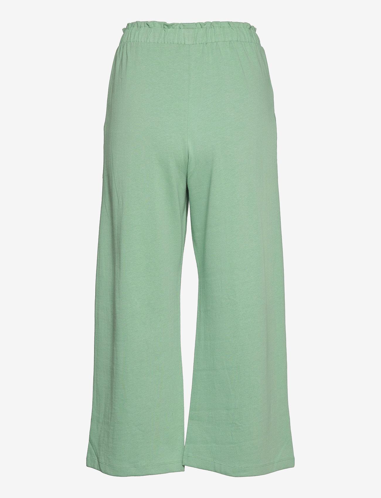 Mango - CLAY - bukser med brede ben - pastel green - 1