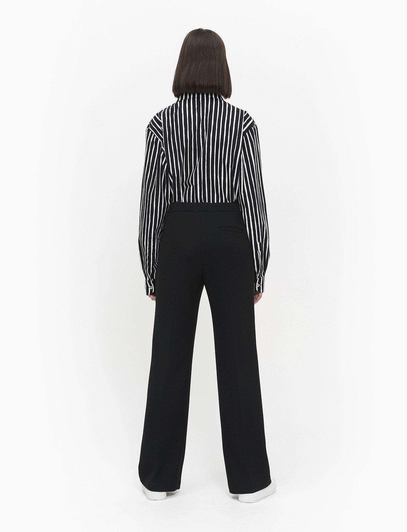 Marimekko HAKKU LONG SOLID TROUSERS - Spodnie BLACK - Kobiety Odzież.