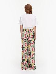 Marimekko - KUKKINUT PIENI TORI TROUSERS - bukser med brede ben - green, rose, yellow - 3