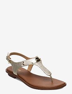 MK PLATE THONG - flat sandals - pale gold