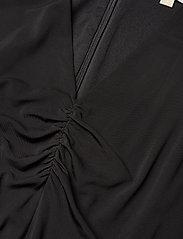 Michael Kors - ELV FLUTTER SLV JMPST - kombinezony - black - 4