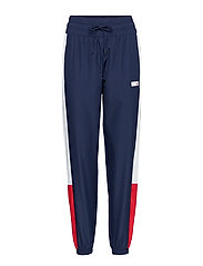 NB ATHLETICS WIND PANT - PIGMENT
