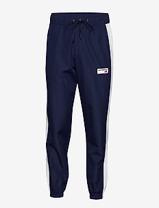 NB ATHLETICS WINDBREAKER PANT - PIGMENT