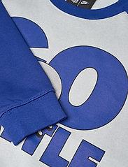 NIKE Fan Gear - Seattle Seahawks Nike Go Helmet Historic Raglan Sweatshirt - sweats - field silver / old royal - 3
